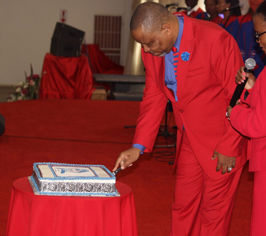 Pastor Cutting The Cake